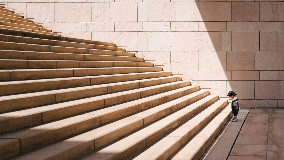 persevering in front of large steps