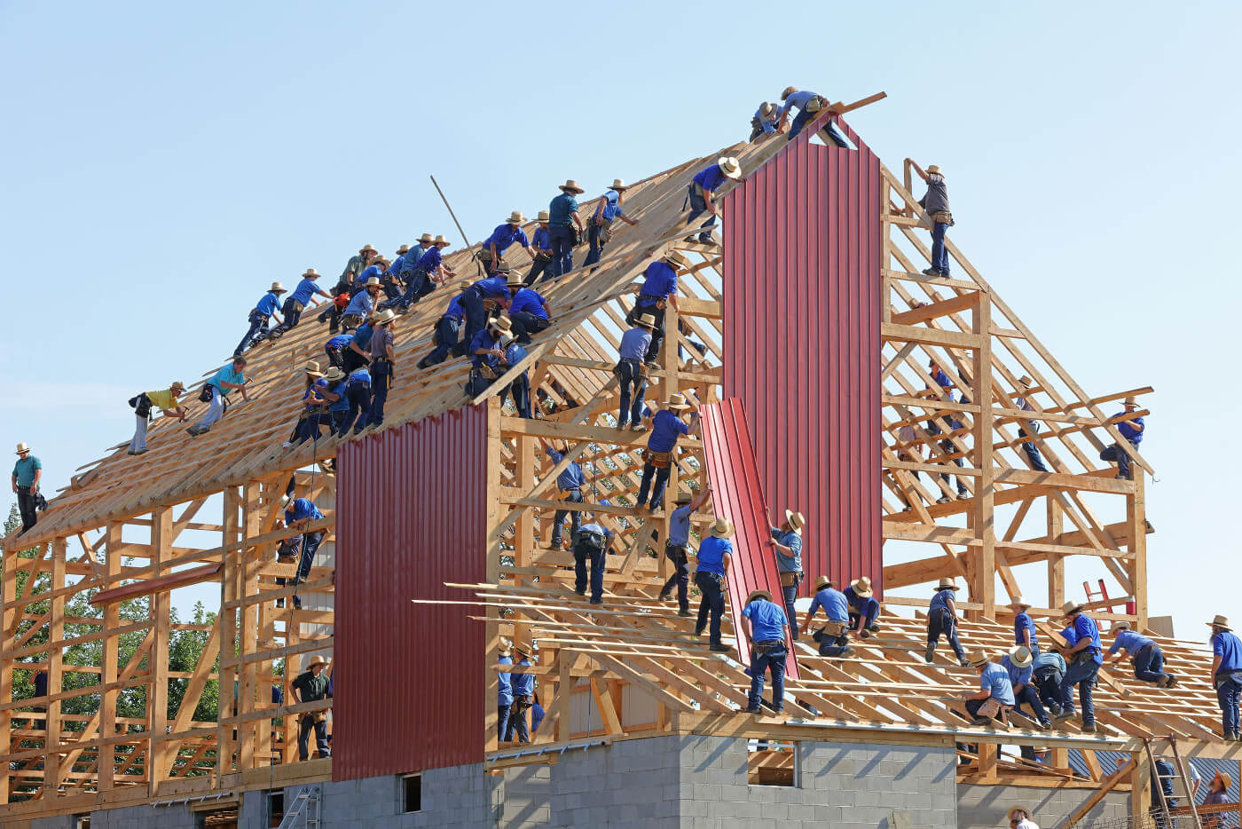 People building a house together