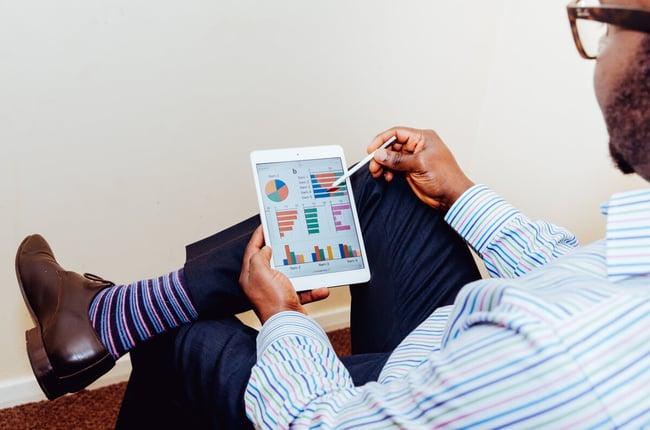Man sitting, looking at idea challenge data