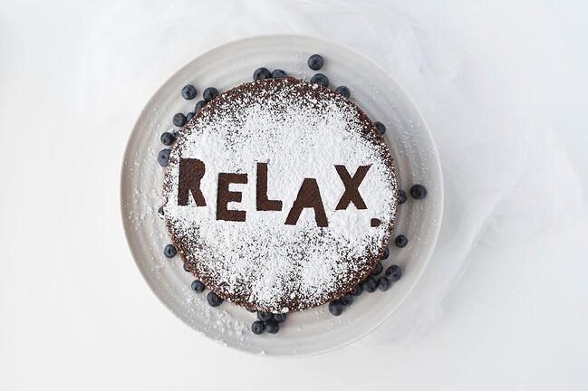 "A cake with ""Relax"" written on it"